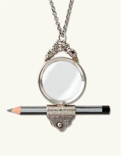 Magnifier necklace with pencil holder