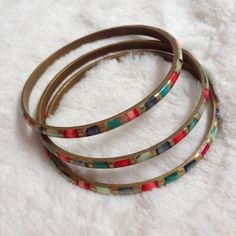 """Vintage Brass and Multi-stone Inlay Bangles These beautiful vintage brass bangles have colorful multi-stone inlays in blue, red and turquoise. Set of 3. One stone is missing from one of the bangles. (See 1st pic, top right of top bracelet.) Barely noticeable given the color variations. 2 5/8"""" diameter. Jewelry Bracelets"""