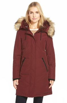Free shipping and returns on Vince Camuto Down & Feather Fill Parka with Faux Fur Trim at Nordstrom.com. A cold-weather parka in a feminine A-line silhouette gets a double dose of coziness from an overlay of faux shearling to warm the neck and a lush ring of faux coyote fur topping the hood.