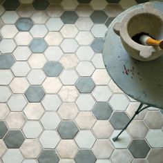 Add glamour to the floor with a smattering of metallic terracotta floor tiles.