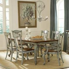 Make mealtimes extra special with the Pulaski Jolie 7-Piece Dining Set with Rectangular Table. This dining set includes a rectangular wooden table and six dining chairs. Exquisitely crafted the tabletop features a plank design in a warm cherry finish.  $3479.99