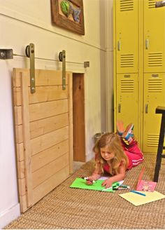 """For a playroom or """"secret place""""    Google Image Result for http://www.rollingdoorhardware.com/images/T/wire%2520rail%2520system%2520barn%2520door%2520hardware%2520sized.jpg"""