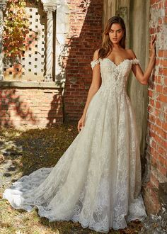 Eve of Milady - Boutique wedding dresses Style 1599 IVORY/BLUSH strapless Alencon lace soft A-line with three dimensional flowers, chapel train. Colors available are Solid Ivory, Solid White, White/Blush. Sizes 2-24.