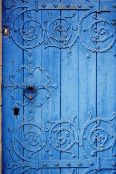 wood, patina, metal, scrolls and unbelievably blue.