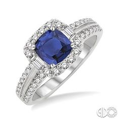 Styled in lustrous 14 karat white gold this alluring ring is adorned with a centrally staged cushion cut sapphire, embellished with dazzling 44 prong and pave set baguette and round cut diamonds, framing a square platform and flow down the shank in brilliant rows. #swansondiamondcenter #ring #sapphire #diamond