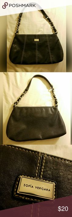 Sofia Vergara purse Purse from Sofia Vergara's line she had with Kmart. Only used once and in great condition. The bag does reflect a bit of light so anything you see on the purse is just that. I am willing to accept any reasonable offer! ^.^ Bags Shoulder Bags