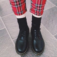 Dr. Martens 1461 Shoe teamed with tartan trousers.