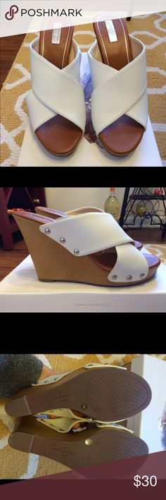 """Jessica Simpson platform wedge sandal Jessica Simpson platform wedge sandal. Never worn. Color white. Size 8.5. Criss cross straps with inside elastic insert for stretch fit. 1"""" platform,4"""" wedge heel. Jessica Simpson Shoes Sandals"""