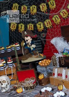 boy's pirate Mickey birthday party table decorations www.spaceshipsandlaserbeams.com