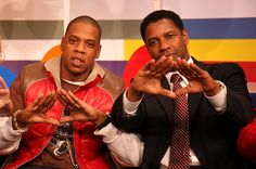 "Jay Z and Denzel Washington. Jay-Z has fully embraced the diamond hand sign of the Illuminati and he frequently encourages his fans to join him in ""raising their diamonds."" He also features occult phrases on his Rocawear clothing line. Denzel Washington, Albert Pike, Afro, Beyonce And Jay Z, New World Order, Black History, Hip Hop, Photos, Pictures"