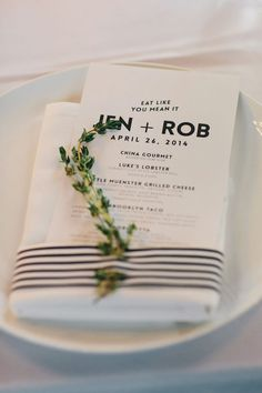 black and white paper goods with striped ribbon, photo by Clean Plate Pictures http://ruffledblog.com/stylish-green-building-wedding #weddingideas