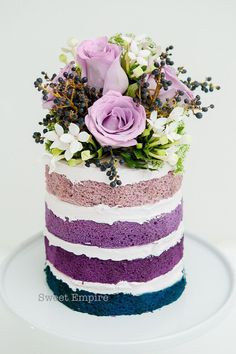 An ombre lavender sponge cake decked with floral emanates. LOVE LOVE!