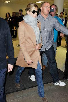 Jennifer Aniston, camel coat, grey scarf, jeans