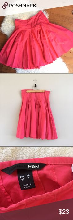H&M Hot Pink Pleated Midi Skater Skirt Gorgeous bright pink pleated full skirt from H&M. Below the knee/midi length and has a flattering cut that is snug around the waist and flares out just at the hips - adorable and retro! Bought at H&M in London. Fabric has a bit of stretch, and hidden side zipper. Waist: 15.5in, length: 23.5in, cotton/spandex blend. Gently worn, great condition. H&M Skirts Midi