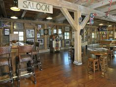 I like the center post. We have to put one in the basement for support so am trying to find a clever way to spice it up. Bar Country, Trophy Rooms, Bar Games, Room Themes, Western Bar, Western Saloon, Western Rooms, Western Man Cave Ideas, Western Decor