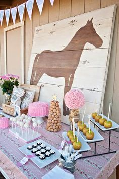Another gorgeous CowGIRL party. I'm loving this horse backdrop for the dessert table !