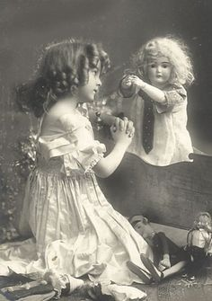 Cute little girl and her dolls