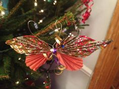 Homemade and recycled Christmas tree decorations - paper butterflies.