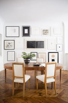 Gretchen says: When a gallery wall is near a sitting area it is important to see how the art looks while sitting down. That horizontal black art is perfectly at eye level.