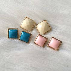 Square earrings Square (or diamond) earrings. Brand new in packaging and on card. Clear backings. Availability- PINK: 5 • BLUE: 5 • WHITE: 5PLEASE do not purchase this listing. Price is firm unless bundled. No trades Discount on earrings is: •2 pairs 15% off • 3-4 pairs 20% off  •5+ pairs 25% off  Boutique Jewelry Earrings