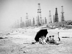 "Haunting photographs of Huntington Beach, Venice Beach, Long Beach and other areas of the Los Angeles Basin, infested with oil towers. When they said Los Angeles was ""built on oil"", they meant it both figuratively and literally. California History, Vintage California, California Beach, Southern California, California California, Art Nouveau, Las Vegas, Huntington Beach California, Surf City"