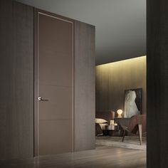 Luxor swing door with polished aluminum structure, door panel, jamb and handle covered with fango leather with cotton stitching in the same colour.