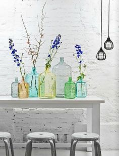 Coloured accessories such as these vases are such a simple way to brighten up a space. So easy to change as well.