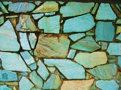 Beautiful turquoise stone wall...would love this for my underdeck patio