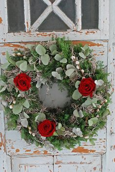 wreath with red roses, pussywillows and eucalyptus