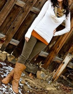 Brown corduroys. White v-neck long sleeve. Dark brown tall boots. Burnt orange under tank. White and tan shiny infinity scarf.