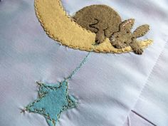 Moon Bunny Quilt by Bustle & Sew, via Flickr -- feather stitch and gold metallic thread on the moon make it sparkling