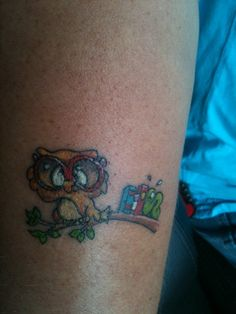 My BFF's nerdy owl tattoo with a book worm struggling to hold up the books -- done at Absolute Tattooing in Menomonee Falls, WI