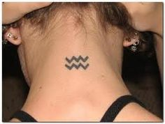 Aquarius tattoo. pretty cool. I wish I was an aquarius..