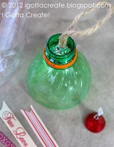 DIY giant hollow #Kiss tutorial made from a soda bottle and aluminum foil. Great #Valentines Day project at I Gotta Create!
