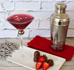 True Love Valentine Martini  1 oz vodka  2 oz pomegranate juice  2 oz chilled champagne  Strawberry slices