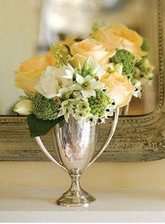 flowers in a trophy centerpiece