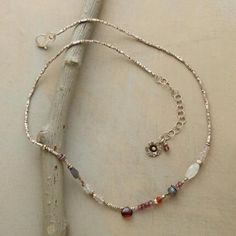 """GARNETS AND MORE NECKLACE A garnet teardrop and gemstone necklace, with fiery garnets forming a blaze of red amidst labradorites, moonstones and pink quartz. Handmade in USA with sterling and Thai silver beads. Lobster clasp; flower charm on extender chain. Exclusive. 17-1/2"""" to 19-1/2""""L."""
