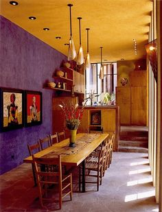 CASA DE LAS ESTRELLAS: Shafts of light spill between square columns onto a 200-year-old carpenter's table, framed to become the 11-foot dining table.