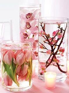 Distilled Water + Silk Flowers + Dollar Store Vases, beautiful centerpieces..