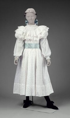 Girls in white dresses with blue satin sashes . . . American, 1899. Printed cotton dress, cotton blouse and silk sash.