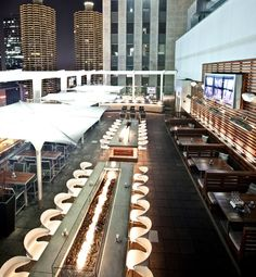 Capture up-close views of Chicago's downtown architecture from the Roof on the Wit. The Hangover, an intimate glass-enclosed space with views of Lake Michigan, that features a private table for eight perched 27 stories above the city.