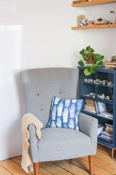 A cosy armchair makes for the perfect reading nook in a living room