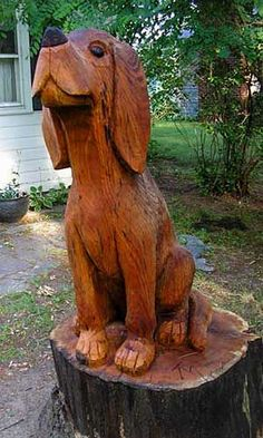 :-) tree-carved-hound-dog Wow, enjoy MANY delightful artworks featuring animals!