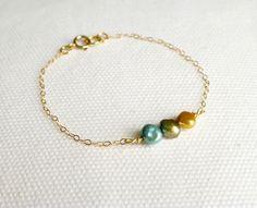 Colored Freshwater Pearl Bracelet - Dainty Bracelet - Modern Pearl Jewelry - Minimalist Bracelet - 14k Gold or Sterling Silver Chain. $28.00, via Etsy.