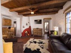 You can not ask for more charm than in this darling one bedroom casita. Honoring the old world traditions of Santa Fe the recent remodel of this historic adobe home is nothing short of delightful. Casita Besos is situated in Santa Fes finest East Side neighborhood. You will be staying just a couple blocks away from some of the best restaurants Santa Fe offers. Geronimos, El Farol, The Compound and the Tea House