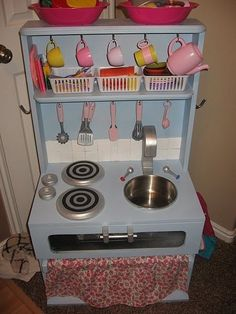 Another really cute play kitchen made from old furniture.