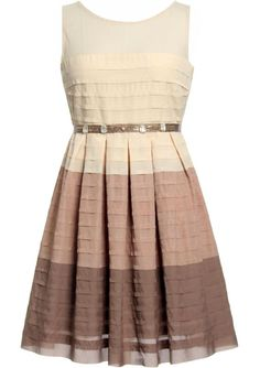 Dissolving Sugar Dress: Features a delicate mesh yoke with rear keyhole closure, brilliant ivory bodice with proceeding blush and cocoa layers below it, jeweled satin belt which ties behind the back for added femininity, and dimension-lending pleats cascading down both sides of the dress to finish.