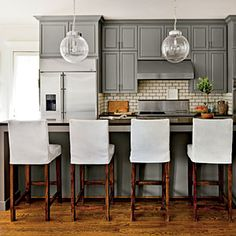 Let There Be White! | Add Finishing Touches | SouthernLiving.com    slipcovered bar stools , painted cabinets