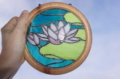 Water Lilly stained glass on a hand lathed oak frame.