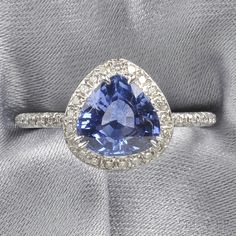 18kt White Gold, Sapphire, and Diamond Ring, Fred Leighton, prong-set with a triangular-cut sapphire measuring approx. 7.90 x 8.10 x 4.00 mm, framed by full-cut diamond melee, pavé diamond shank
